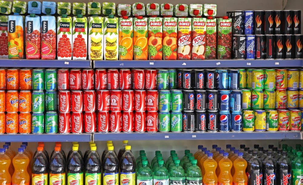 Bottles of soft drinks on a market shelves